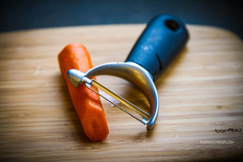 Vegetable peeler and carrot.