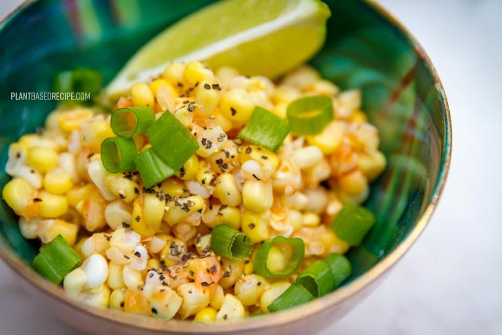 Corn cut off the cob and spiced with hot sauce and lime.