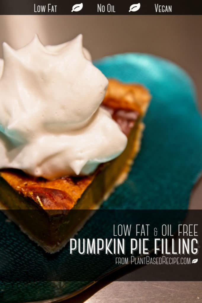 Vegan pumpkin pie with whipping cream on top.